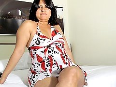 Horny housewife getting wet on her bed