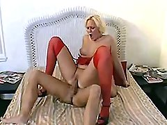 Blond milf in red lingerie goes wild riding big cock