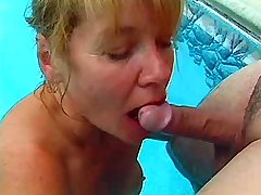 Mature sucks cock in pool and gets licking pussy
